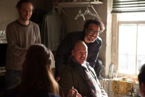 Cinematographer Emmanuel Lubezki, Michael Keaton and Director Alejandro G. Iñárritu on the set of BIRDMAN.