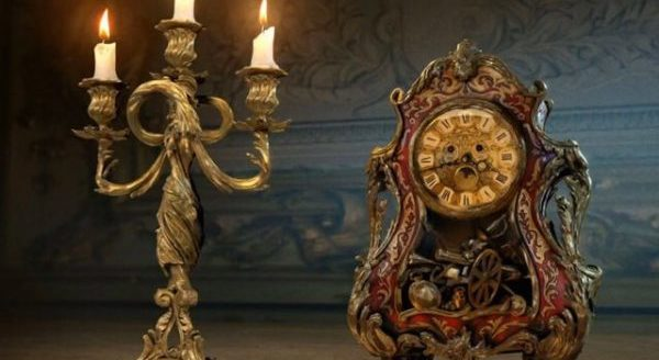 Lumiere and Cogsworth are in a predicament in BEAUTY AND THE BEAST. Courtesy of Walt Disney Pictures.
