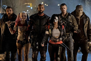 L-R: Jai Courtney, Margot Robbie, Will Smith, Karen Fukuhara, Joel Kinnaman and Adewale Akinnuoye-Agbaje are a few of the stars that make up the SUICIDE SQUAD. Photo courtesy of Warner Bros.