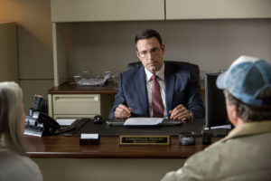 Ben Affleck punches numbers - and people - as Christian Wolff in THE ACCOUNTANT. Courtesy of Warner Bros. Pictures.